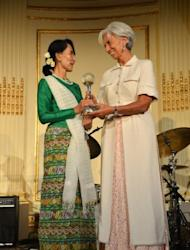 Aung San Suu Kyi, Myanmar's Member of Parliament and Nobel Peace Prize Laureate, receives the Atlantic Council 2012 Global Citizen Award from Christine Lagarde, Managing Director of the International Monetary Fund (IMF), on September 21, in New York.