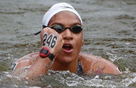 Cunha of Brazil celebrates winning the gold medal in the women's 25km open water race at the 16th FINA World Championships in Kazan
