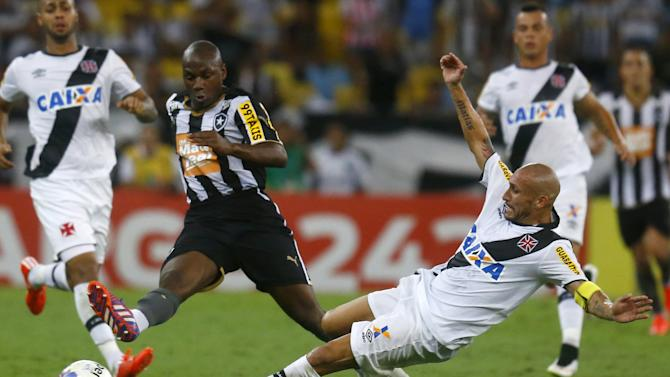 Brazil's Guinazu from Vasco and Sassa from Botafogo battle during their Carioca Championship final soccer match at the Maracana stadium in Rio de Janeiro