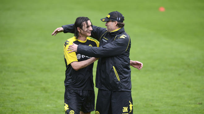 Dortmund's Head Coach Juergen Klopp (R) Shares A Joke With Dortmund's US Defender Neven Subotic  AFP PHOTO / ODD AFP/Getty Images
