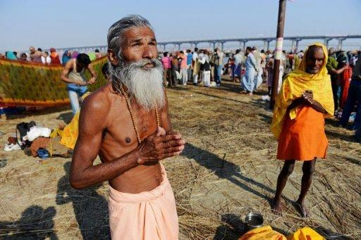 A Hindu devotee prays on the banks of the Ganges river at the Kumbh Mela in Allahabad, on February 9, 2013