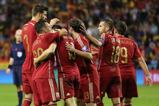 Spain's midfielder Santi Cazorla (2L) celebrates with teammates during the Euro 2016 qualifying football match Spain vs Luxembourg at Las Gaunas stadium in Logrono on October 9, 2015
