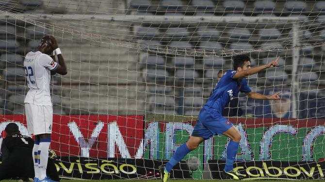 Belenenses' Pedro celebrates his goal near Porto's Mangala during their Portuguese Premier League soccer match in Lisbon