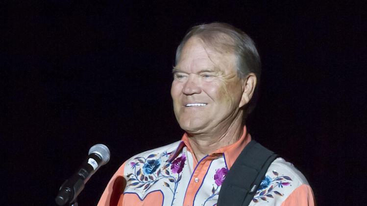 FILE - This Sept. 6, 2012 file photo shows singer Glen Campbell performing during his Goodbye Tour in Little Rock, Ark. Campbell will be in Washington, D.C., Monday, April 22, 2013, advocating for Alzheimer's disease research. The trip includes attendance at a fundraising dinner for the Alzheimer's Association and a visit to Capitol Hill where he'll appear to underscore the importance of Alzheimer's research on a visit to the Senate. (AP Photo/Danny Johnston, file)