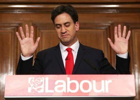 Ed Miliband gestures as he resigns as Britain's opposition Labour Party leader in London