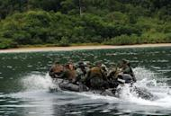 "Philippine and US marines speed towards the shore of Tagcauayan beach during a beach raid simulation as part of their joint military exercise in Puerto Princesa, Palawan island, on April 23. The Philippines, lamenting the poor state of its armed forces, appealed Monday for US and international help in building a ""minimum credible defense"" amid an escalating territorial dispute with China"