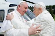 """Picture released by the Vatican press office on March 23, 2013 shows """"pope emeritus"""" Benedict XVI (R) greeting Pope Francis upon his arrival at the heliport in Castel Gandolfo. Pope Francis flew in to a papal residence near Rome on Saturday for an unprecedented encounter with Benedict XVI -- the first time a pontiff has met his predecessor"""
