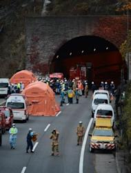 Japanese rescue workers and police gather outside the Sasago tunnel along the Chuo highway near Otsuki city after part of the tunnel collapsed. Japanese rescuers found five charred bodies and a trucker was pronounced dead after being pulled from his vehicle following the collapse