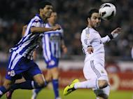 Deportivo's defender Kaka (L) clashes with Real Madrid's forward Gonzalo Higuain during their Spanish league football match at Riazor stadium in Coruna on February 23, 2013. Real Madrid had to come from behind as second-half goals from Kaka and Higuain handed them a hard-fought 2-1 at relegation threatened Deportivo La Coruna