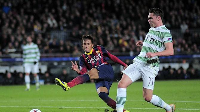 FC Barcelona's Neymar, from Brazil, left, duels for the ball against Celtic's Derk Boerrigter during a Champions League soccer match group H at the Camp Nou in Barcelona, Spain, Wednesday, Dec. 11, 2013
