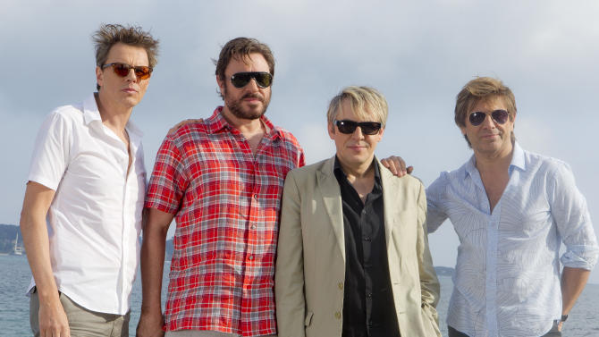 FILE - From left, John Taylor, Simon Le Bon, Nick Rhodes and Roger Taylor of Duran Duran pose for photographs at the 64th international film festival, in Cannes, southern France, Friday, May 13, 2011.  Veteran New Romantic band Duran Duran has called off its summer tour because frontman Simon Le Bon is recovering from voice problems. The European tour had been due to start in Dublin next week and continue through mid-September.   Le Bon said Tuesday July 5 2011 he had damaged muscles controlling his vocal cords, leaving him unable to hit top notes, and had been advised to undergo physical therapy. (AP Photo/Joel Ryan, file)