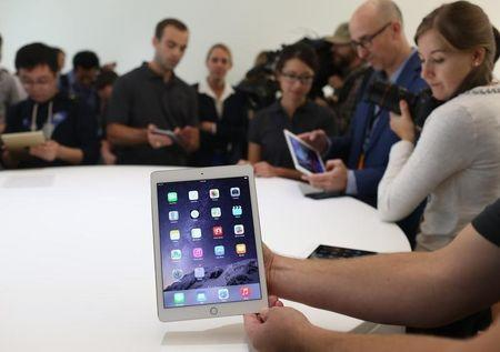 A new iPad is seen follownig a presentation at Apple headquarters in Cupertino