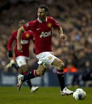 Manchester United's Ryan Giggs runs with the ball during a Premiership match against Spurs at White Hart Lane on March 4, which Man U won 3-1. Manchester United, overloaded with debt since their takeover by a billionaire American family of investors, is moving to raise cash through a US share sale