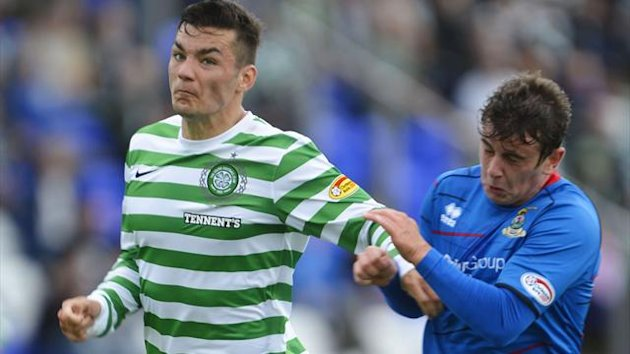 Celtic's Tony Watt (L) is challenged by Inverness Caledonian Thistle's Aaron Doran