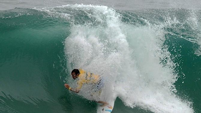 Portuguese surfer Tiago Pires competes in the Association of Surfing Professionals' men's 2012 ASP World Championship Tour at Barra da Tijuca beach in Rio de Janeiro, Brazil, on May 14, 2012.  AFP PHOTO/VANDERLEI ALMEIDAVANDERLEI ALMEIDA/AFP/GettyImages