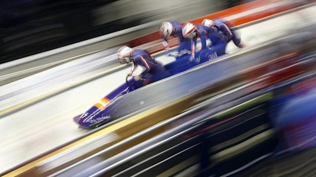 Britain's bobsleigh team start a run at the start of a World Cup race held as a bobsleigh test event (Reuters)
