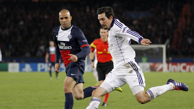 Anderlecht's Sacha Kljestan, right, prepares take a shot while PSG's Alex looks on during their Champions League group C soccer match against Paris Saint Germain in Paris, France, Tuesday, Nov. 5, 2013. The match ended in a 1-1 draw