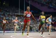US' Carmelita Jeter wins the women's 4 x 100m relay final at the athletics event of the London 2012 Olympic Games on August 10, 2012 in London