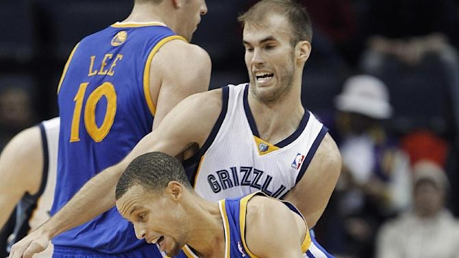 Golden State guard Stephen Curry (30) gets around Memphis Grizzlies guard Nick Calathes, back, in the second half of an NBA basketball game Saturday, Dec. 7, 2013, in Memphis, Tenn. Golden State won 108-82