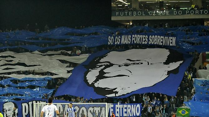 "An image depicting FC Porto's president Jorge Nuno Pinto da Costa is held by fans in the stands during FC Porto's Portuguese League soccer match against Nacional, at the Dragao stadium in Porto, Portugal, Saturday, Nov. 23, 2013. Due to heart problems, the 75-year-old president, was hospitalized for a week. The banner reads ""Only the strongest survive. """