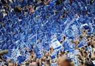 Portsmouth supporters cheer during the FA Cup Final football match at Wembley, in north London, on May 15, 2010. Portsmouth have been told they face the threat of explusion from the Football League if the Pompey Supporters Trust (PST) fail in their bid to buy the League One club