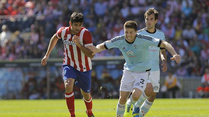Atletico de Madrid's Diego Costa from Brazil, left, in action with Celta de Vigo's Andreu Fontas, centre, and Borja Oubina, right, during a Spanish La Liga soccer match at the Vicente Calderon stadium in Madrid, Spain, Sunday, Oct 6, 2013