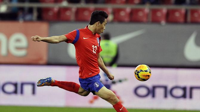 South Korea's Park Chu-young scores the opening goal against Greece during a friendly match at Georgios Karaiskakis stadium in Piraeus port, near Athens, Wednesday, March 5, 2014