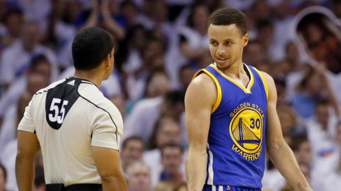 Golden State Warriors guard Stephen Curry (30) talks with referee Bill Kennedy (55) during the first half against the Oklahoma City Thunder in Game 4 of the NBA basketball Western Conference finals in Oklahoma City, Tuesday, May 24,, 2016. (AP Photo/Sue Ogrocki)