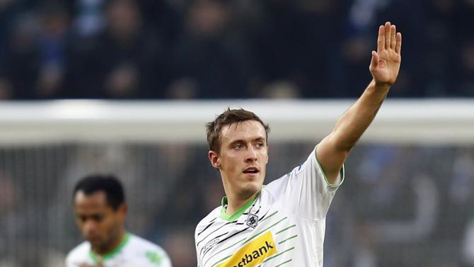 Borussia Moenchengladbach's Kruse celebrates his goal against Schalke 04 during their German first division Bundesliga soccer match in Moenchengladbach