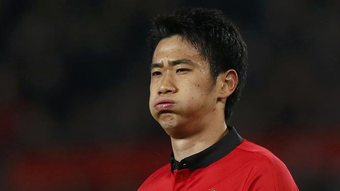Manchester United's Kagawa reacts during their English Premier League soccer match against Manchester City in Manchester