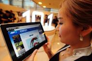 A Samsung employee unveils the Galaxy Tab 10.1 in Seoul. Apple told a US court Tuesday it will seek damages of more than $2.5 billion from Samsung in a patent infringement case accusing the South Korean firm of copying the iPhone and iPad maker