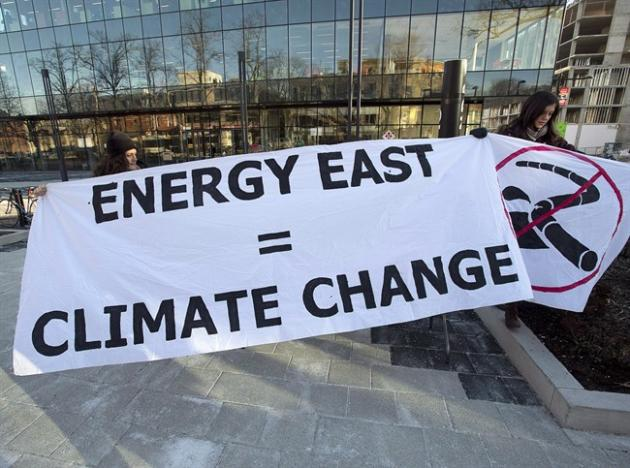 Members of Stop Energy East Halifax protest outside the library in Halifax on Monday, Jan. 26, 2015. More than 60 organizations are calling on the National Energy Board to suspend TransCanada's application for the Energy East Pipeline. THE CANADIAN PRESS/Andrew Vaughan