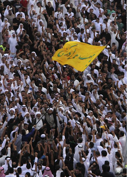 Shi'ites chant slogans during a rally following Friday's suicide attack at a Shi'ite mosque, at Qatif in east Saudi Arabia