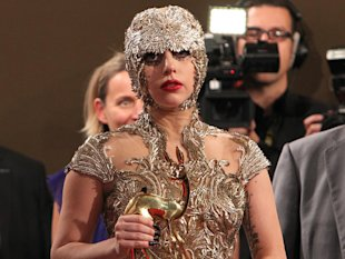 US singer Lady Gaga leaves with her International Pop award during the Bambi awarding ceremony in Wiesbaden, Germany