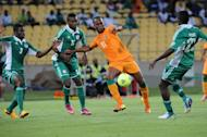 Didier Drogba (C) clashes with Kenneth Omeruo (R) in Rustenburg yesterday in an Africa Cup of Nations game