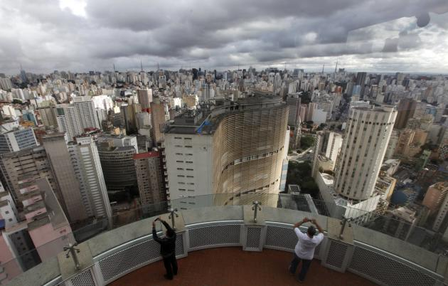 Tourists take photos of the city of Sao Paulo