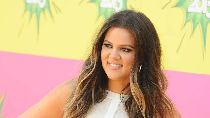 "FILE - In this March 23, 2013 file photo, Khloe Kardashian arrives at the 26th annual Nickelodeon's Kids' Choice Awards, in Los Angeles.  Kardashian is left out following the latest game of musical chairs on ""The X Factor."" Fox said Monday, April 22, 2013,  that while Mario Lopez is returning this fall as host of Simon Cowell's music competition series, Kardashian will not be joining him. (Photo by Jordan Strauss/Invision/AP, File)"