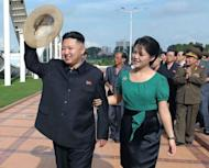 "North Korean leader Kim Jong-Un (L), accompanied by his wife Ri Sol-Ju (R), visit the Rungna People's Pleasure Ground in Pyongyang. While Kim Jong-Il's wives were never pictured at official functions, ""the regime is now facing a different situation, and the move is part of work to make Kim Jong-Un appear old and wise enough to rule"", said Seoul-based online newspaper the Daily NK"