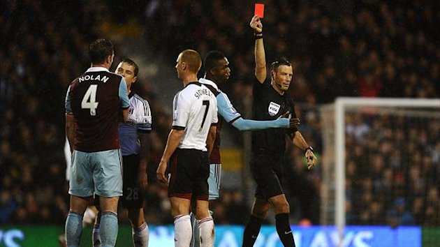 West Ham United's Kevin Nolan is shown a red card by referee Mark Clattenburg (PA)