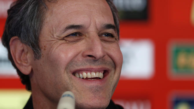 In this Sept. 5, 2013 file photo Austrian head coach Marcel Koller attends a news conference for the FIFA World Cup 2014 qualification group C soccer match between Germany and Austria in Munich, southern Germany. Koller will remain Austria coach for at least two more years, putting aside an offer from his native Switzerland to take over from Ottmar Hitzfeld after next year's World Cup. The Austrian football federation said Wednesday, Oct. 30, 2013, Koller will sign a contract to the end of 2015, with an automatic extension to mid-2016 if Austria qualifies for the European Championship in France