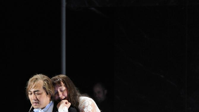 In this June 10, 2013 picture provided by the Frankfurt Opera House, Elza van den Heever , as Duchess Helene, right, and Alfred Kim as Henri, a young Sicilian, perform in Frankfurt, Germany, during a dress rehearsal for the rarely heard original French version of the Opera 'Les vepres Siciliennes' (The Sicilian vespers) by Giuseppe Verdi which had its premiere on June 16 at the Frankfurt Opera. (AP Photo/Thilo Beu,Frankfurter Oper)