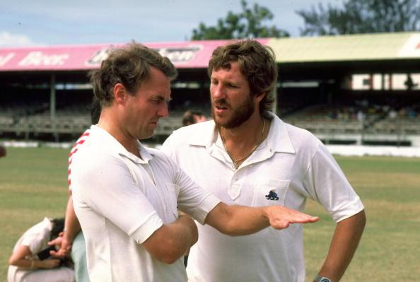 Undated:  England Manager Alan Smith discusses tactics with Captain Ian Botham before a match. \ Mandatory Credit: Adrian  Murrell/Allsport