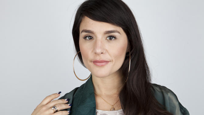 "In this April 2, 2013 photo, British singer-songwriter Jessie Ware poses for a portrait, in New York. In August Ware released her first album, ""Devotion,"" in Europe, where it debuted at No. 5 and was nominated for the prestigious Mercury Prize. She's been buzzed about on the music blogs, and the album was released in America last week with two new tracks. (Photo by Amy Sussman/Invision/AP)"