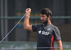 Indian cricketer Cheteshwar Pujara stretches during a team training session at the Sher-e-Bangla National Cricket Stadium in Dhaka on February 24, 201...