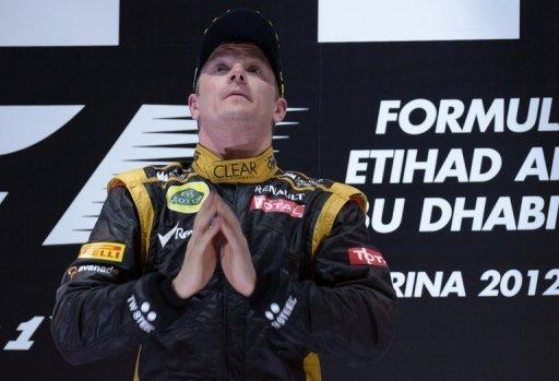 Lotus F1 Team's Finnish driver Kimi Raikkonen celebrates on the podium at the Yas Marina circuit on November 4 in Abu Dhabi after the Abu Dhabi Formula One Grand Prix. Raikkonen lived up to his 'ice man' sobriquet by claiming his first win for three years