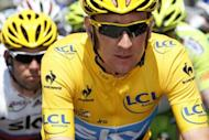Britain's Bradley Wiggins (R) rides with teammate Mark Cavendish in the eighth stage of the Tour de France cycling race starting in Belfort and finishing in Porrentruy, Switzerland, on July 8. Wiggins took the lead of the race on Saturday after a commanding performance by his Sky team on the race's first climbs on stage six