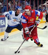Russian Alexander Ovechkin (R) vies for the puck with Finnish Ossi Vaananen. Russia won 6-2
