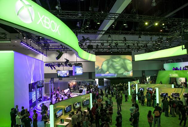 FILE - In this June 5, 2012 file photo, show attendees walk past Microsoft XBox booth at E3 2012 in Los Angeles. With the next Xbox expected to finally be revealed Tuesday, May 21, 2013, at Microsoft'