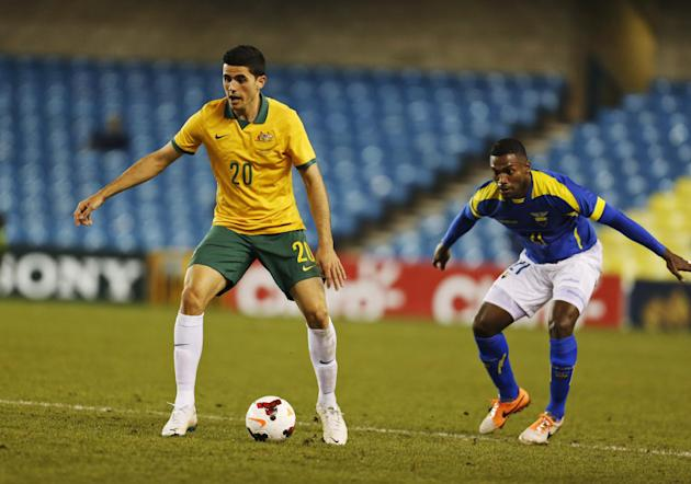 Australia's Tom Rogic, left, controls the ball during a friendly soccer match against Ecuador in London, Wednesday, March 5, 2014. Ecuador won the match 4-3