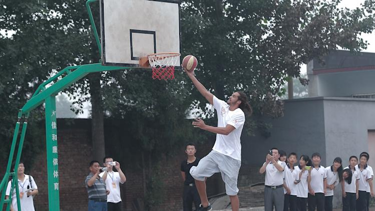 NBA Celebrities Visit A Primary School For Children Of Migrant Workers